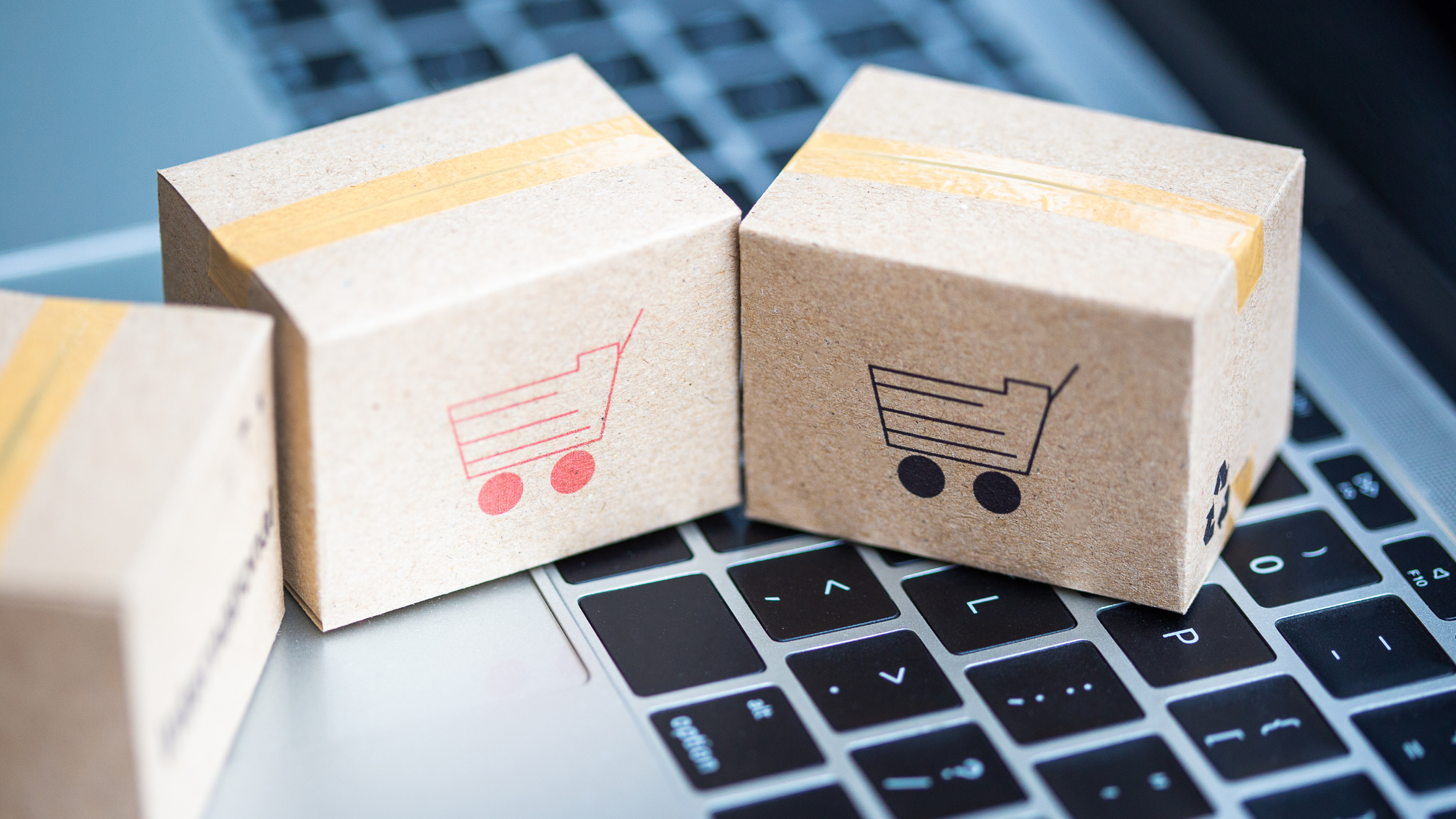 e-commerce three corrugated packaging sitting on a keyboard